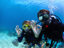 Divers. Scuba divers underwater showing ok signal Stock Photography