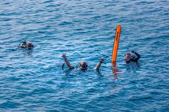 01.08.2017, Ari atoll - Maldives: Scuba divers with sign before diving. Tropical sea activity, underwater royalty free stock images