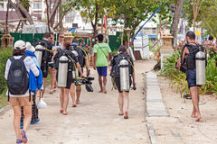Divers walking back from diving trip. Royalty Free Stock Photo