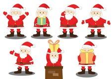 Diversa acción de la alegría de Papá Noel con el regalo Imagen de archivo libre de regalías