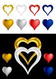 Diversa dimensión de una variable metálica coloreada del corazón Imagenes de archivo