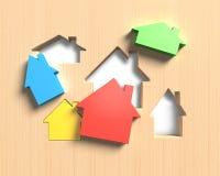 diversas casas coloridas 3D se adaptan al tablero de madera de los agujeros de la forma de la casa Imagenes de archivo