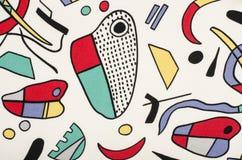 Diversas formas coloridas en la tela blanca Fotografía de archivo