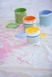 Diversas latas de la pintura en el piso Imagen de archivo libre de regalías