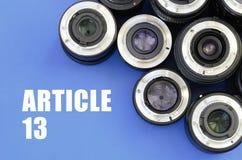 Diversas lentes fotogr?ficas e inscri??o do artigo 13 no azul fotografia de stock royalty free