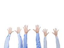 Diversas mãos humanas de levantamento Imagens de Stock