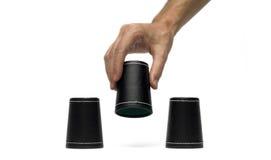 Taza de dados con la mano Imagen de archivo libre de regalías