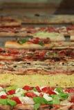 Diversas variedades de pizza Fotos de archivo libres de regalías
