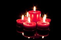 Diversas velas em um fundo preto Fotos de Stock