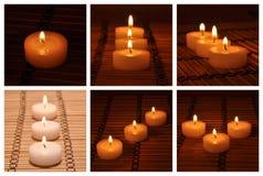 Diversas velas en una alfombra de bambú Imagen de archivo libre de regalías