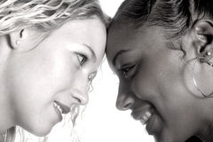 Diverse. Two beautiful and diverse friends Royalty Free Stock Photography