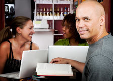 Diverse adult study group. In coffee house Stock Photography