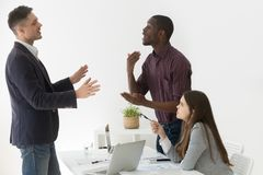 Diverse african and caucasian colleagues having dispute at group. Diverse african and caucasian colleagues disputing at group meeting, multiracial partners stock image