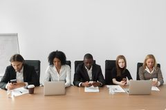 Diverse african and caucasian business people using devices at m royalty free stock image