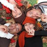 Diverse autumn group. Diverse autumn people fingers on lips Stock Photo