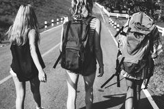 Diverse Backpacker Women Walking along The Street Side Royalty Free Stock Images