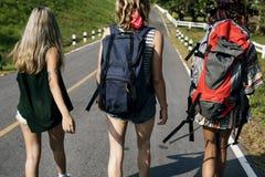 Diverse Backpacker Women Walking along The Street Side Stock Photo