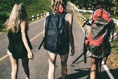 Diverse Backpacker Women Walking along The Street Side Royalty Free Stock Photo