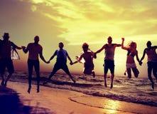 Diverse Beach Summer Friends Fun Jump Shot Concept Stock Photo