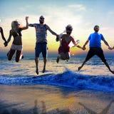 Diverse Beach Summer Friends Fun Jump Shot Concept Stock Image