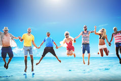 Diverse Beach Summer Friends Fun Jump Shot Concept Stock Images