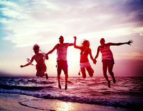 Diverse Beach Summer Friends Fun Jump Shot Concept Royalty Free Stock Images