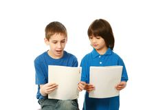 Diverse boys in blue shirts reading Stock Photos