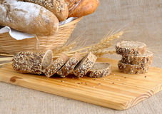 Diverse bread with slices of bread with grains Royalty Free Stock Photo