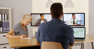Diverse business colleagues working together via the internet. In office royalty free stock photography