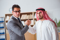 The diverse business concept with arab businessman. Diverse business concept with arab businessman Royalty Free Stock Photo
