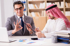 The diverse business concept with arab businessman. Diverse business concept with arab businessman Stock Photo