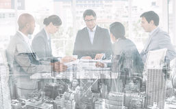 A diverse business group disscussing a budget plan Royalty Free Stock Photos