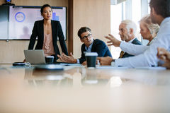 Diverse business group having a meeting in boardroom. Team of business people sitting together in discussion around conference table. Diverse business group Stock Photography