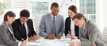 A diverse business group studying a budget plan Stock Photos