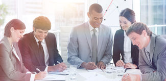 A diverse business group studying a budget plan Royalty Free Stock Photos