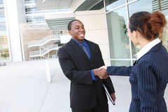 Diverse Business Man and Woman Handshake Royalty Free Stock Photography
