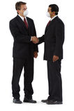 Diverse business men shaking hands with masks Royalty Free Stock Images