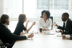 Diverse business partners arguing about bad contract at group me. Diverse business partners arguing about bad contract at meeting in lawyers office, disgruntled Stock Image