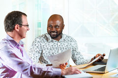 Diverse business partners at desk. Royalty Free Stock Images