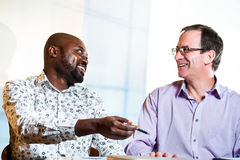 Diverse business partners discussing work. Royalty Free Stock Photography