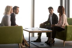 Business partners negotiate in conference room at briefing stock photos