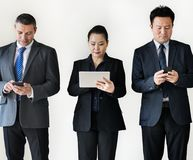 Diverse business people busy on gadgets digital device Stock Image
