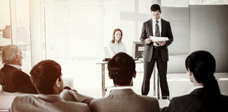 A diverse business people at a conference Stock Image