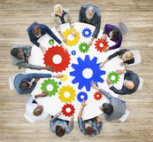 Diverse Business People with Gears Symbol Stock Photos