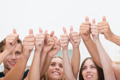 Diverse business people giving a thumbs up Stock Photos