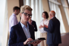 Diverse business people group with blonde  woman in front Stock Images