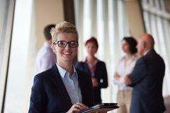 Diverse business people group with blonde  woman in front Royalty Free Stock Image