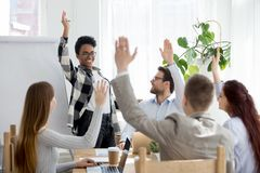 Diverse business people group raise hands at corporate presentation training. Happy multi-ethnic employees team participate in vote volunteering, ask questions stock photos