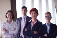 Diverse business people group with redhair  woman in front Stock Photos