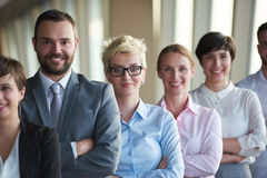 Diverse business people group. Standing together as team  in modern bright office interior Stock Photos